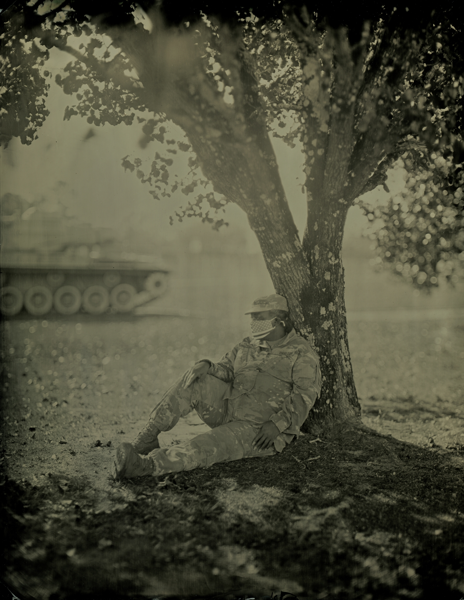 Staff Sgt. Vanessa Lewis Williams sits under a tree for a tintype portrait at the Georgia Army National Guard Readiness Center in Macon, Georgia.